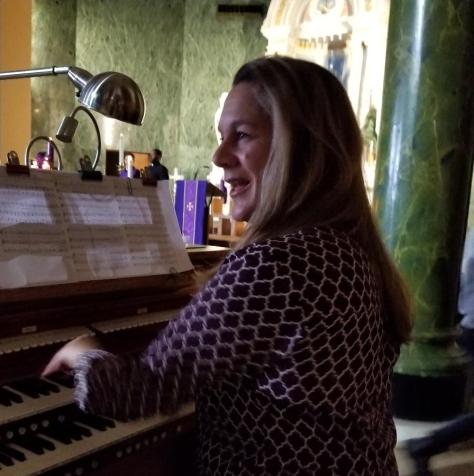 Gods Money Carolyn as Mary Church Organist in Wardrobe